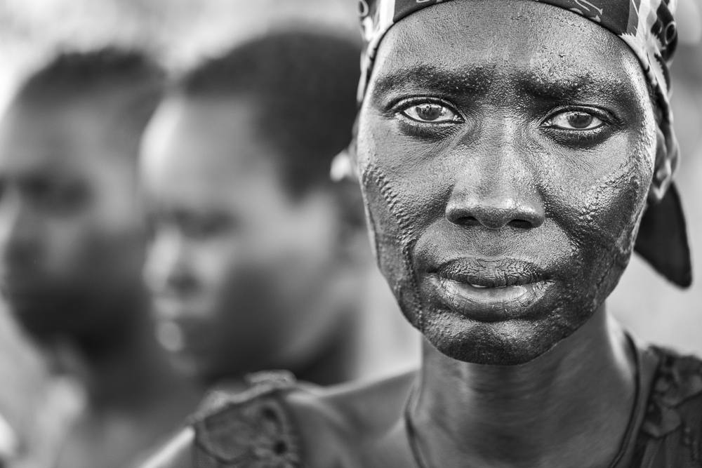 A proud traditional Nuer woman. Her eyes give away the challenges of her life.