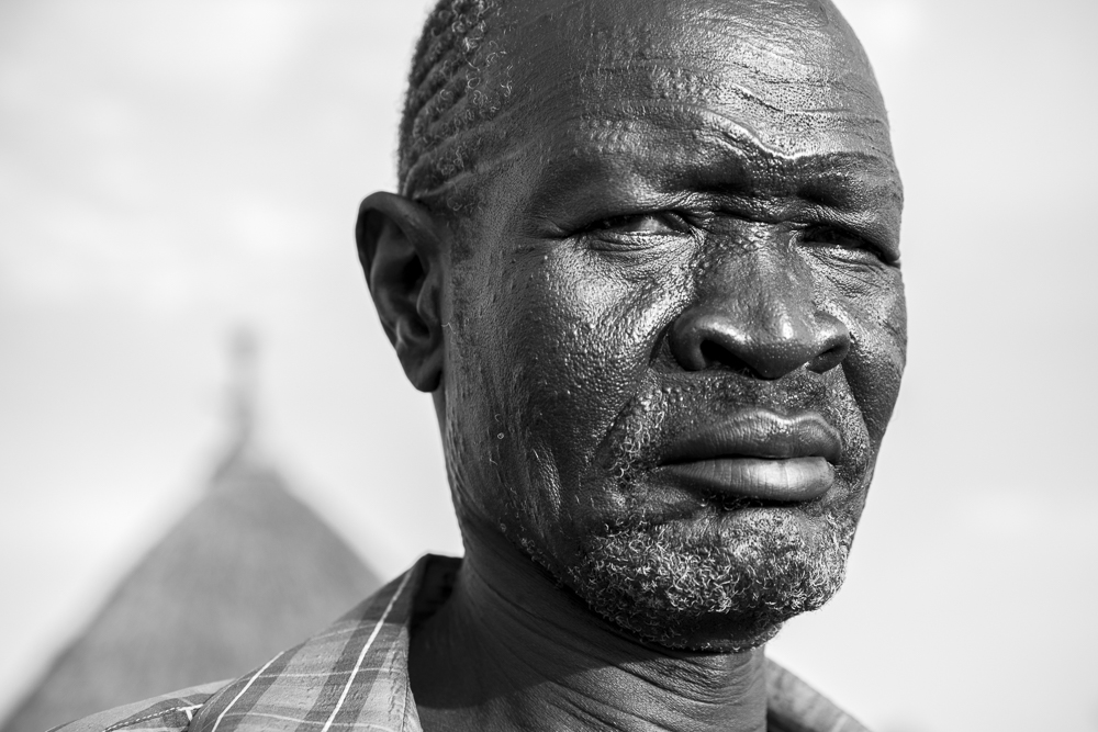 Nuer warrior with deep facial scarring