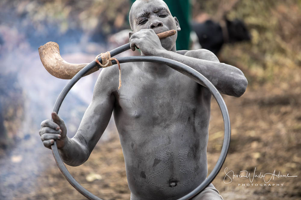 A horn is often played as part of the blood letting and drinking ceremony.