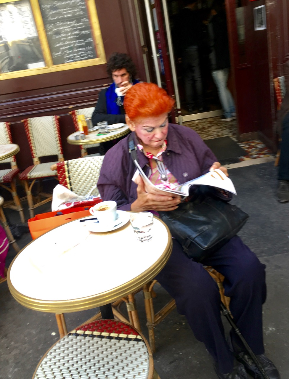 red-haired lady in a café (Paris)