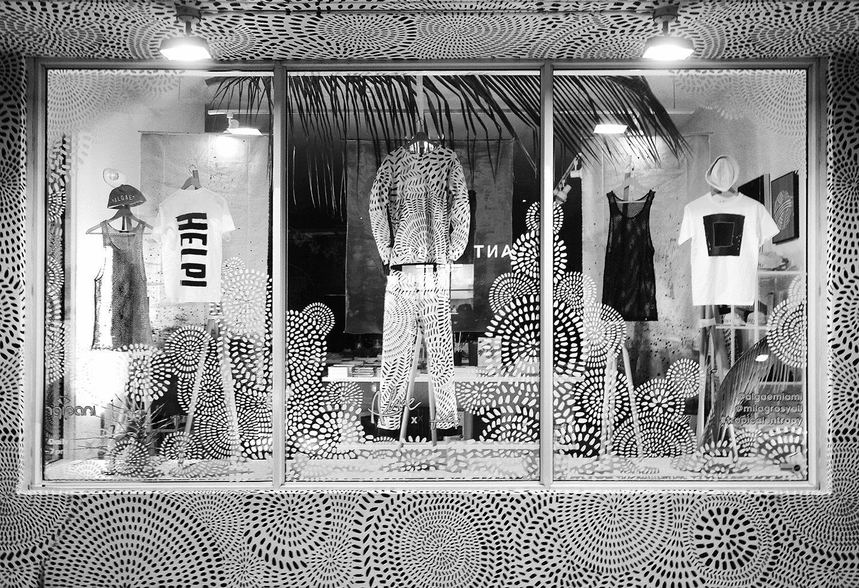 Milagros x Algae Limited Edition Jumpsuit on display alongside Milagros mural.