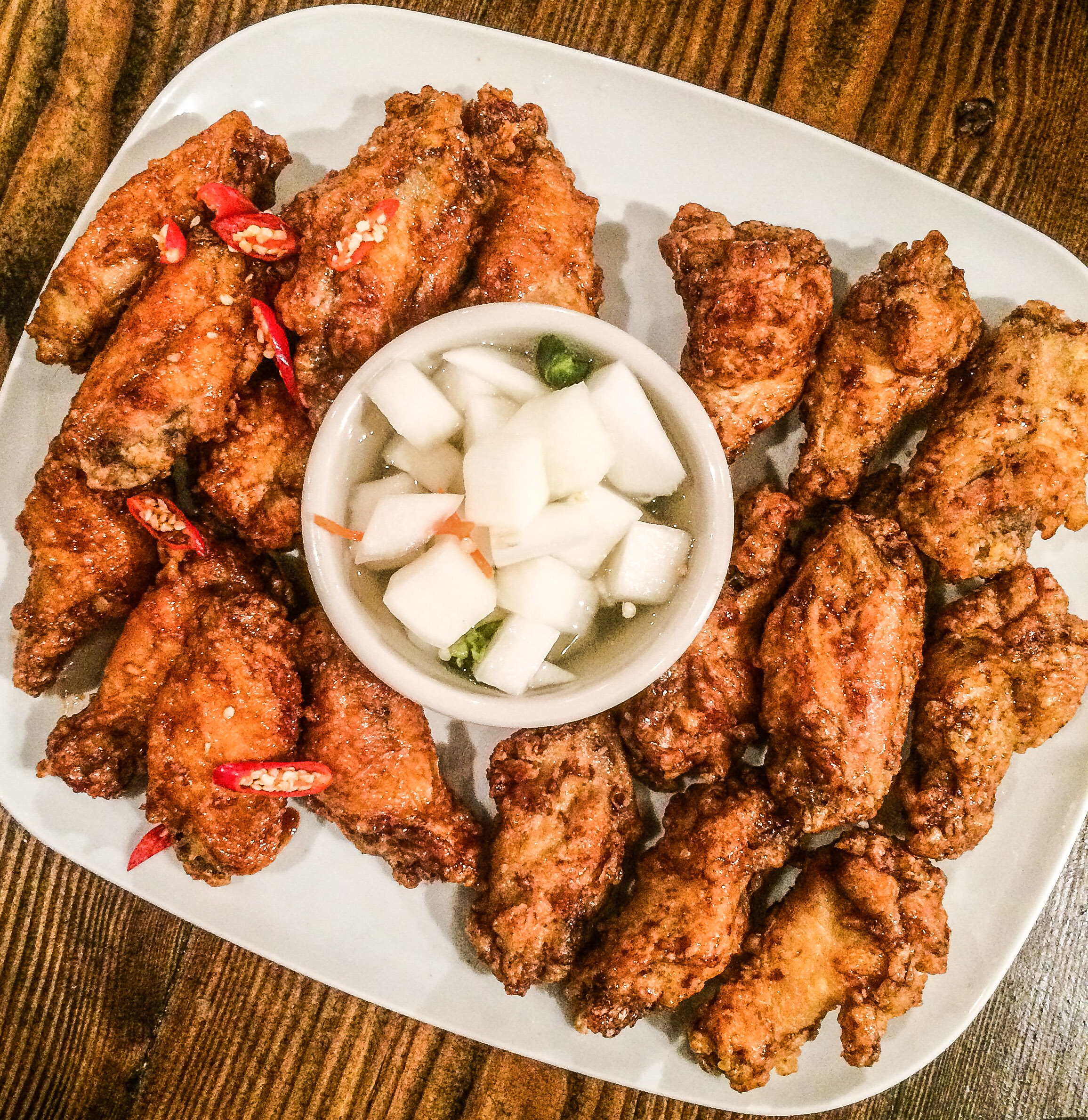 Korean Fried Chicken- Crispy chicken wings glazed with Spicy Korean Sauce or Soy Garlic Sauce.