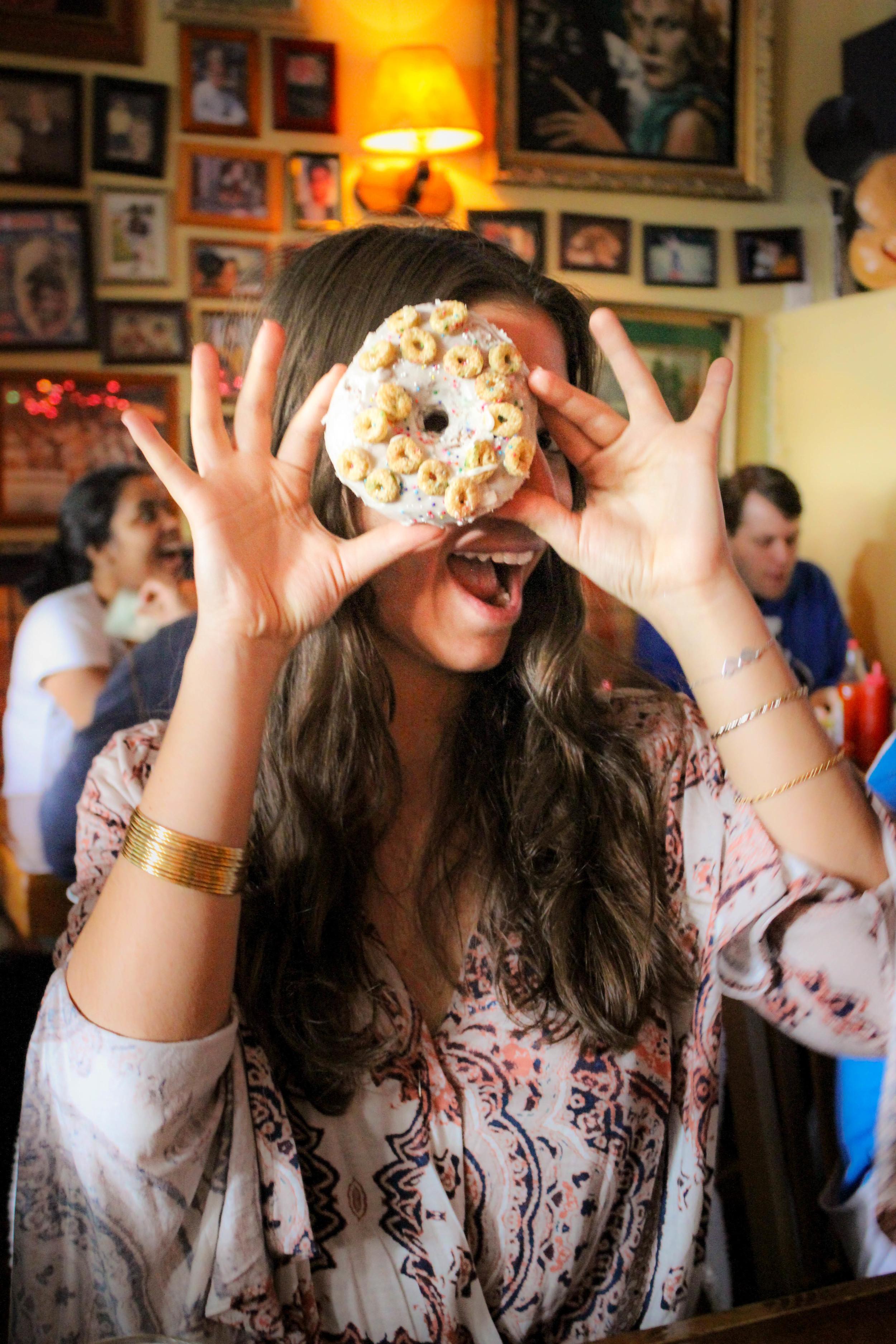 Zehra having fun with the  Cap'n crunch cake doughnut