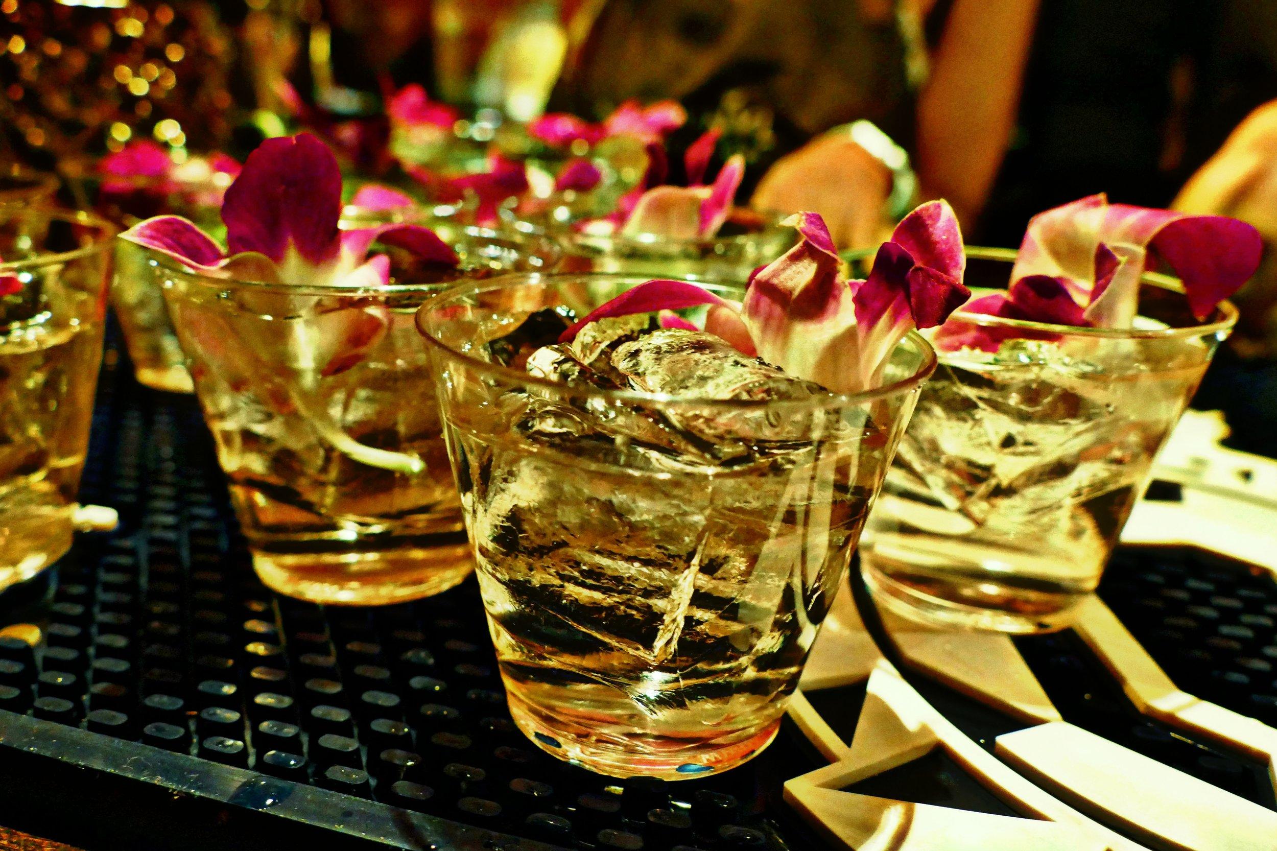 Gareth Howells, of THE VYNL, and the THE MONKEY'S ROOST: Bombay Sapphire® East Gin, St-Germain® Elderflower Liqueur, Dewar's 12 Year Old Scotch, Pineapple, Pink Grapefruit, Jalapeño, Cardamom, Canella, Coriander, Star Anise, Earl Grey Tea, Sencha Green Tea, Milk, Demerara, Orchid Garnish