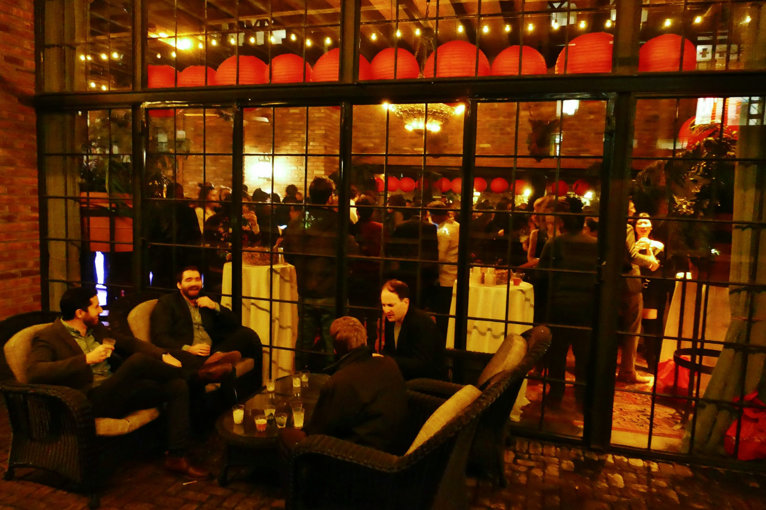 Guests enjoying cocktails on the terrace of The Bowery Hotel.