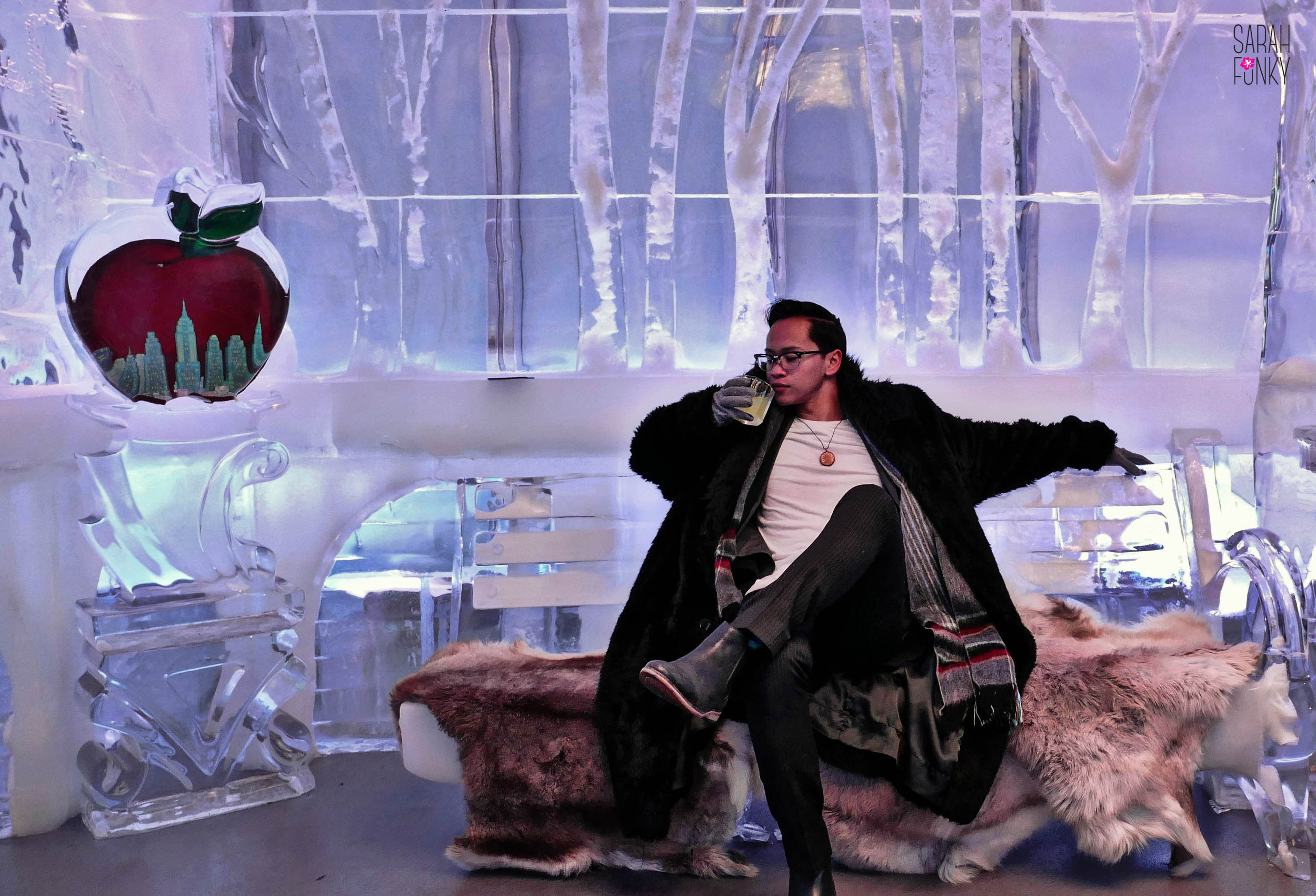 Alex on a bench reminiscent of Central Park, albeit re-imagined in ice and faux fur