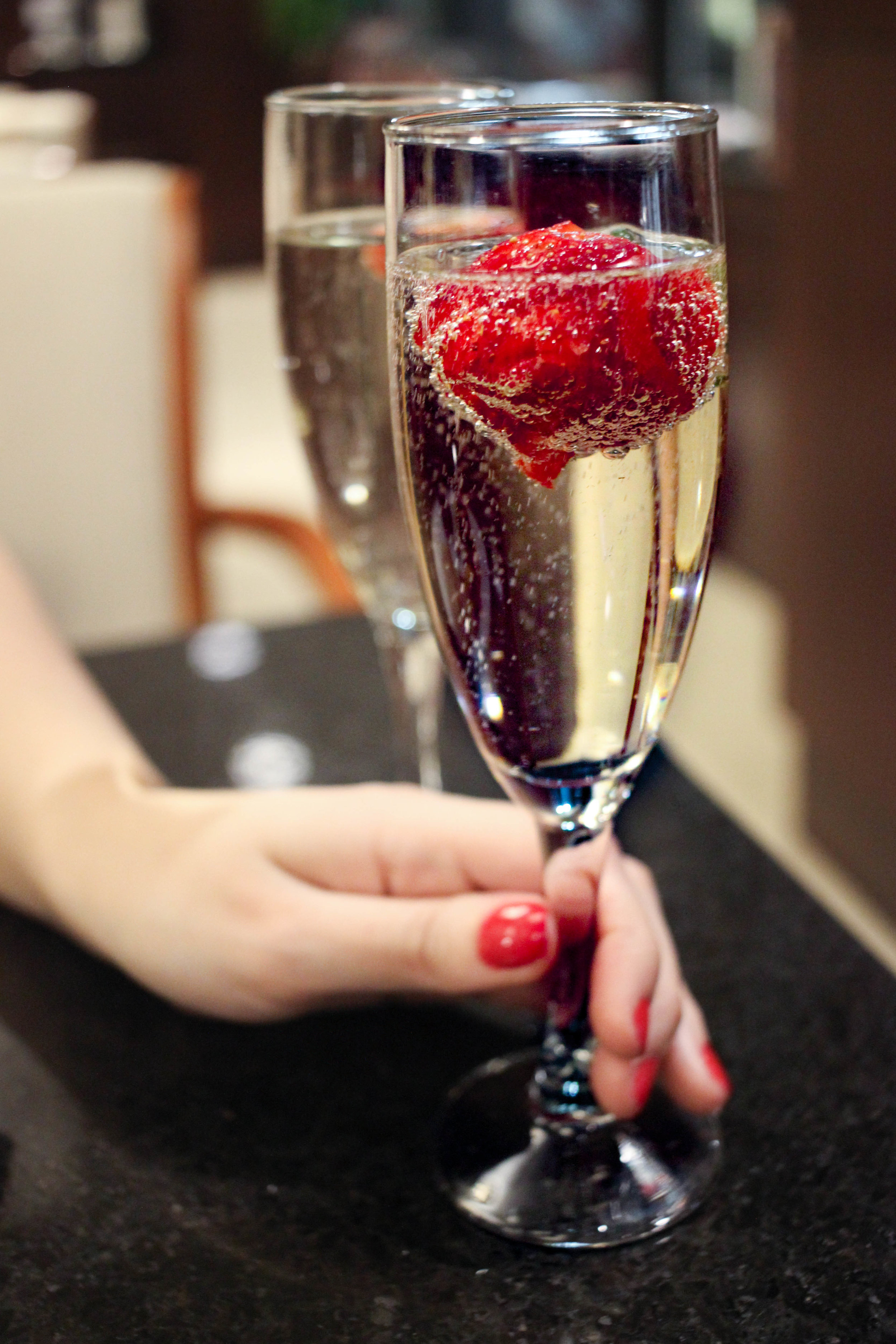 A glass of Prosecco with strawberry