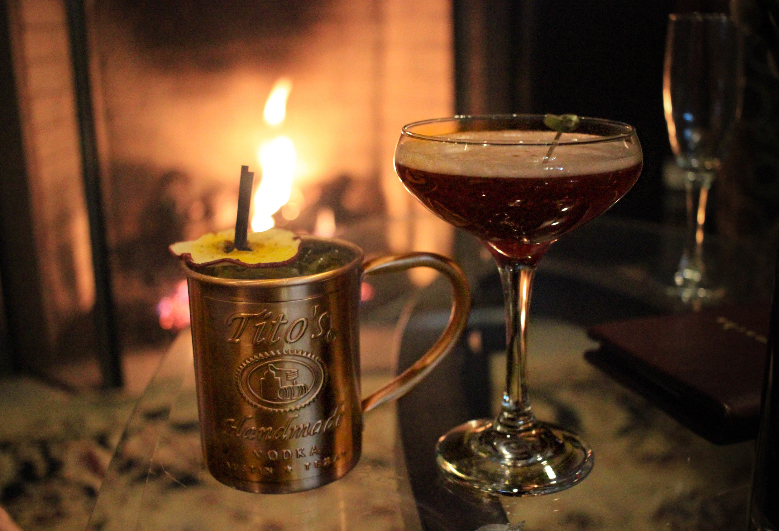 Left: The Autumn Mule; Tito's vodka infused with clove and ginger, peach puree, ginger beer. Right: The Sleepy Hollow; Chai tea infused brandy, cranberry liqueur, pumpkin spiced agave nectar, Sparkling Wine.