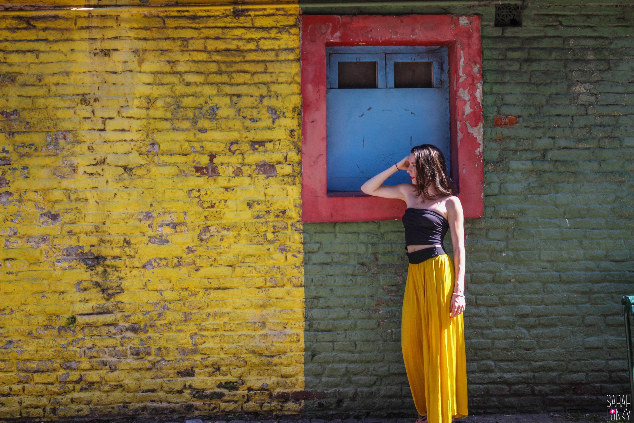 Sarah poses along El Caminito in La Boca.