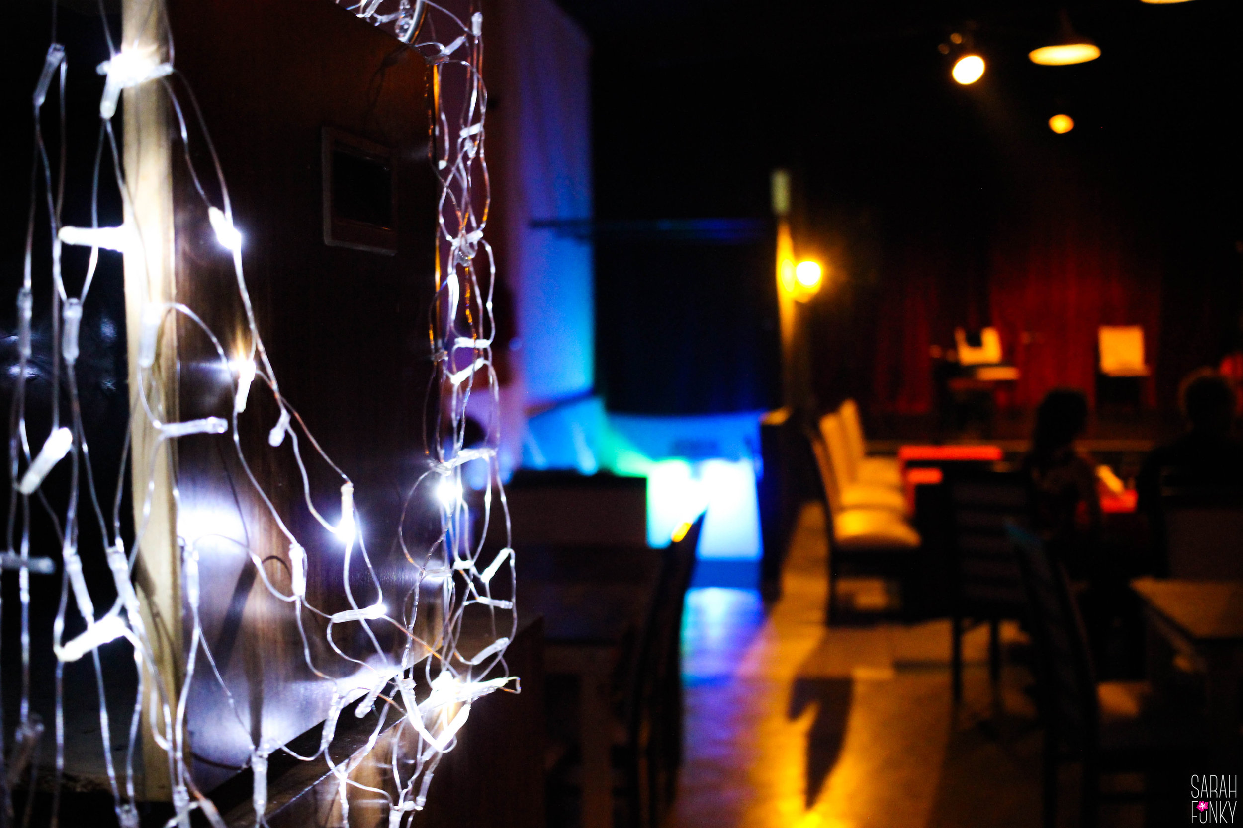 Lights hang from the walls, creating an enchanting atmosphere.