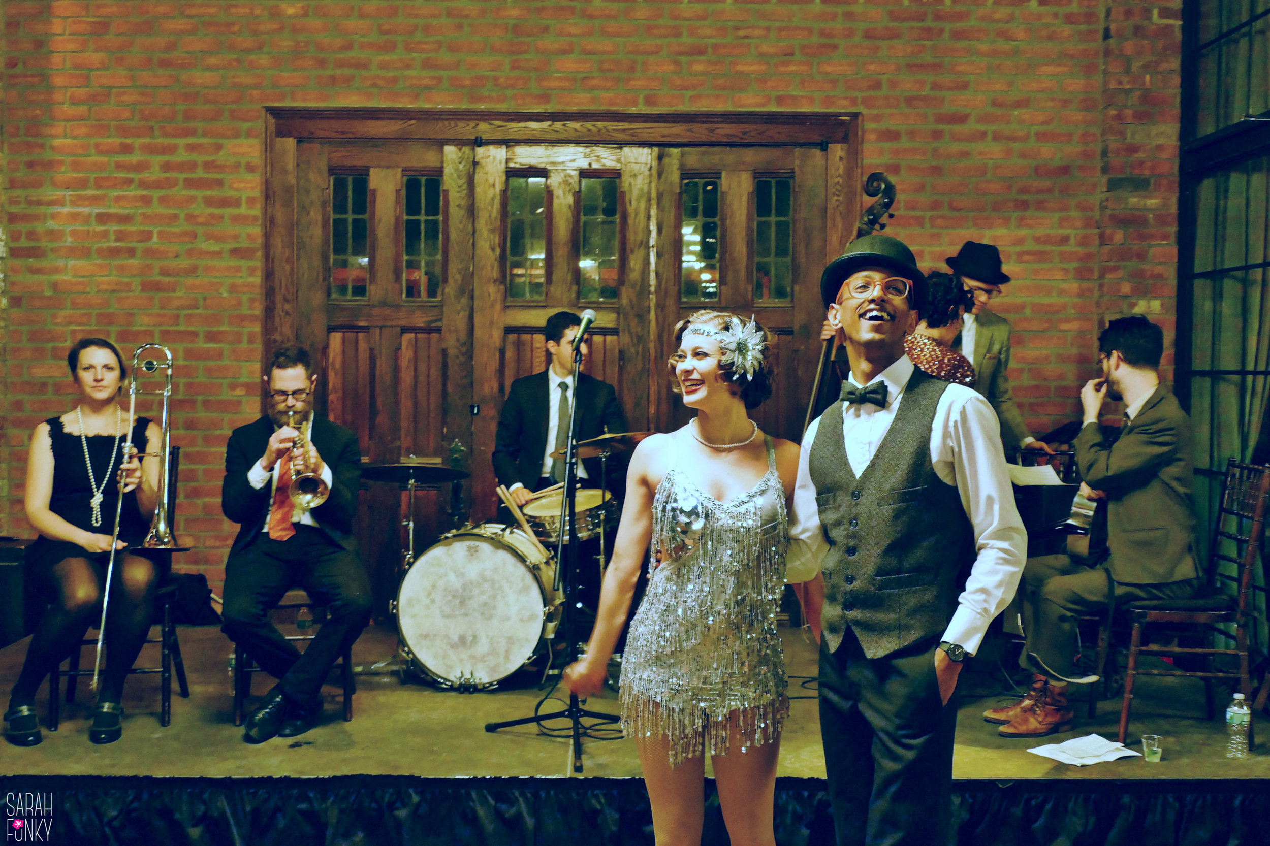 Dancers in flapper dress and Prohibition-style attire