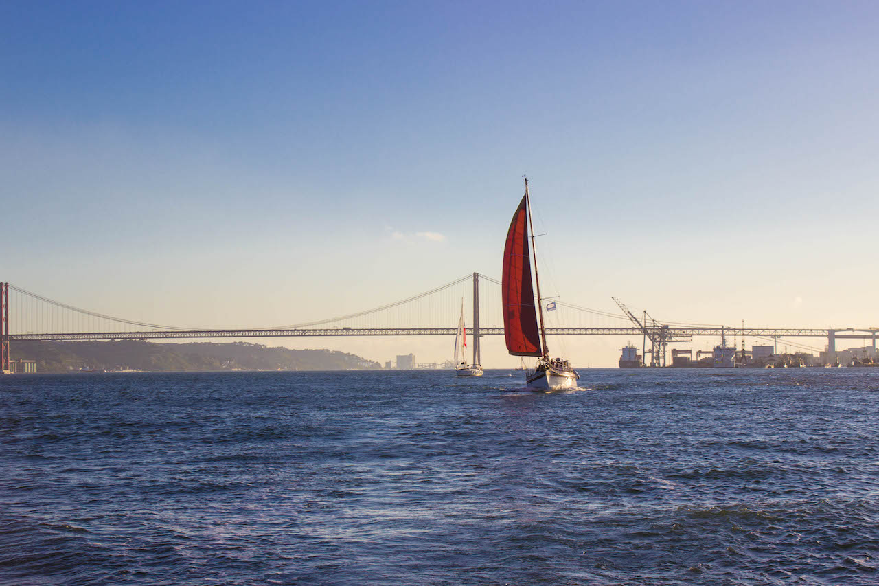 A boat sails along the Tagus River