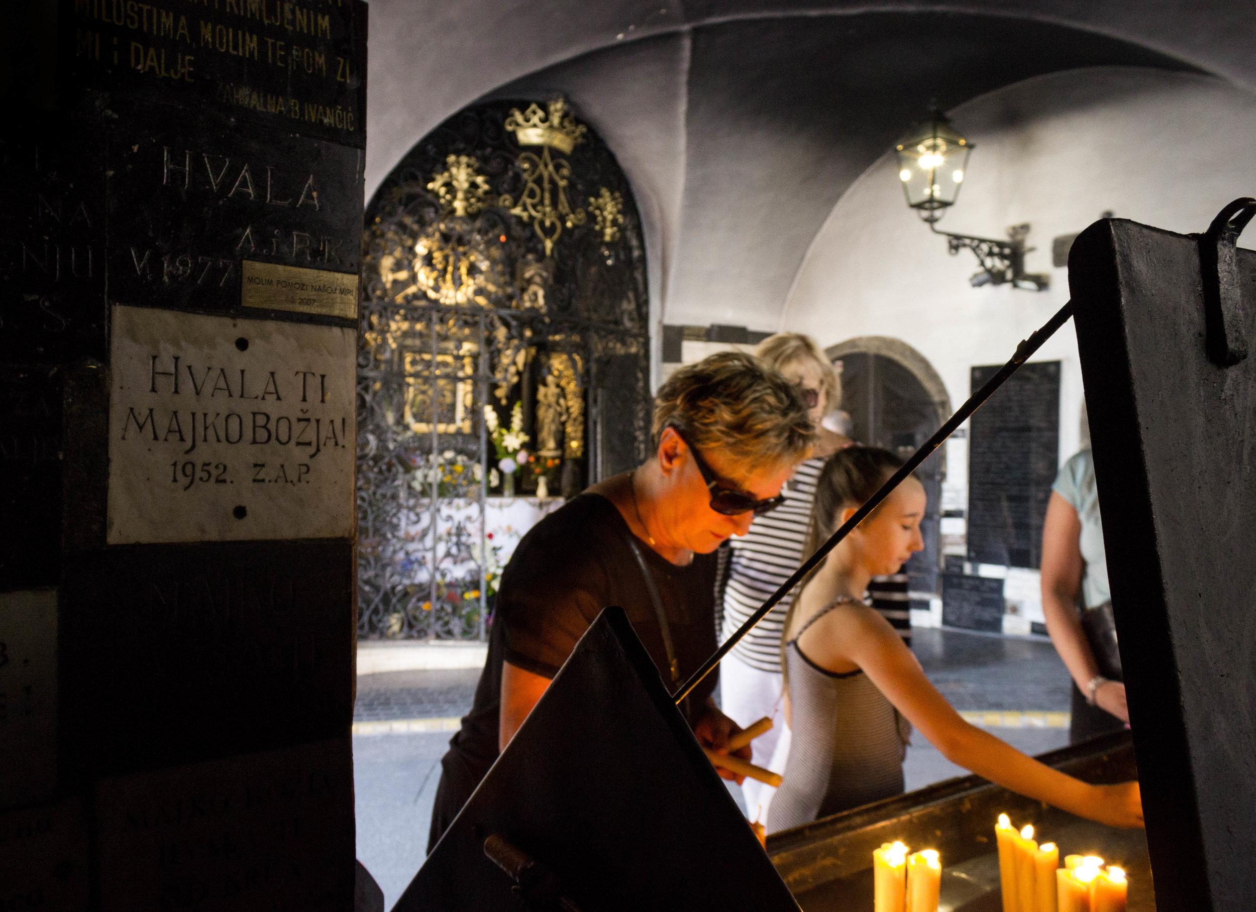Woman praying at the Stone Gate