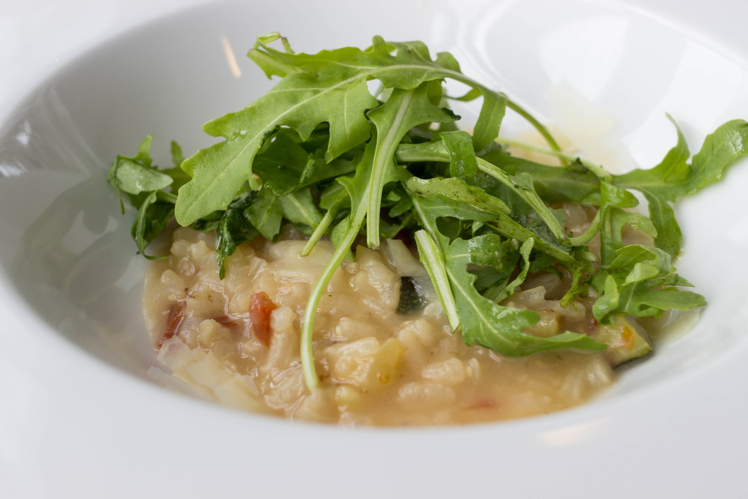 Risotto with dried tomatoes, zucchini and Parmesan cheese