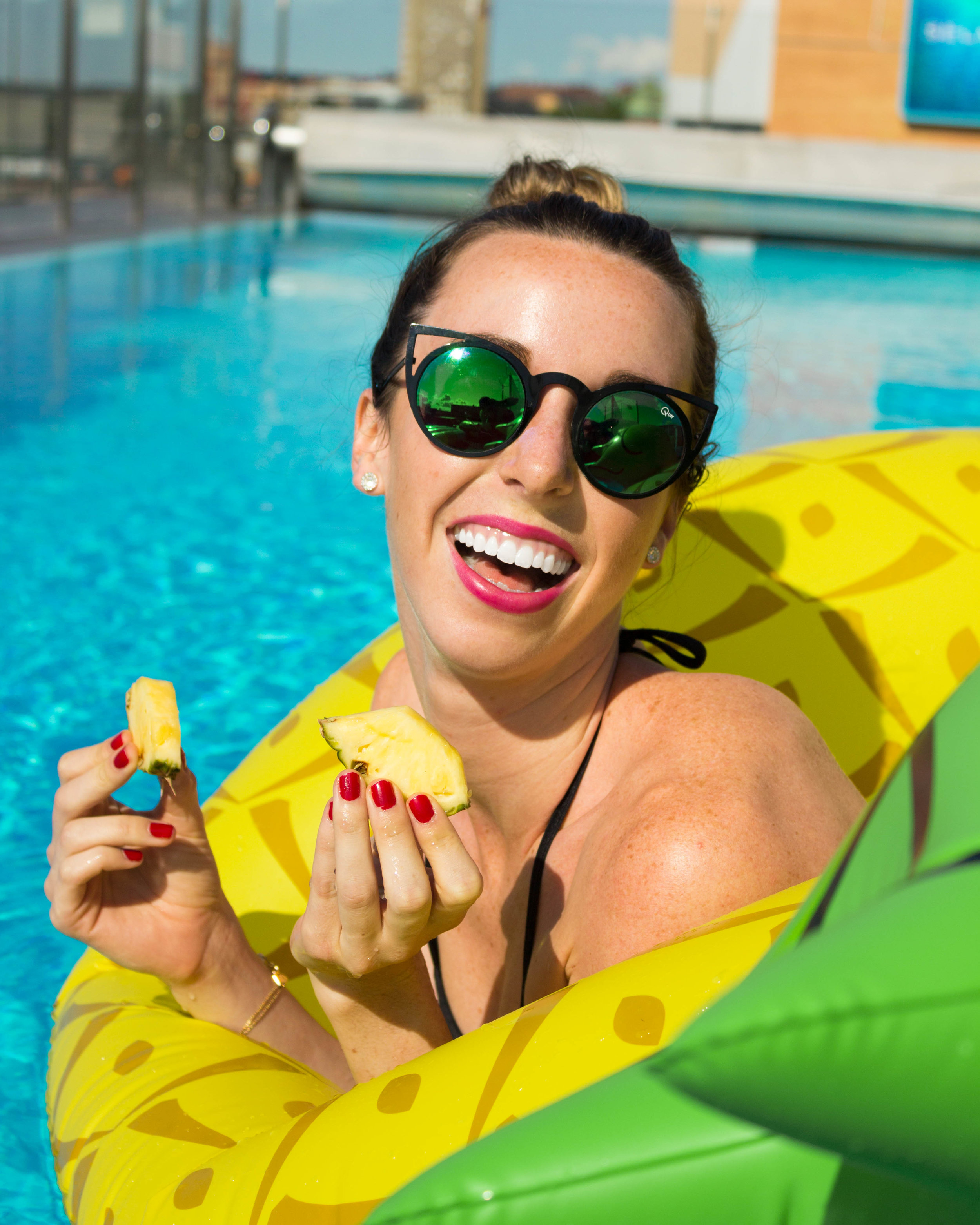 Eating pineapple while sitting in a pineapple floaty = living the dream!