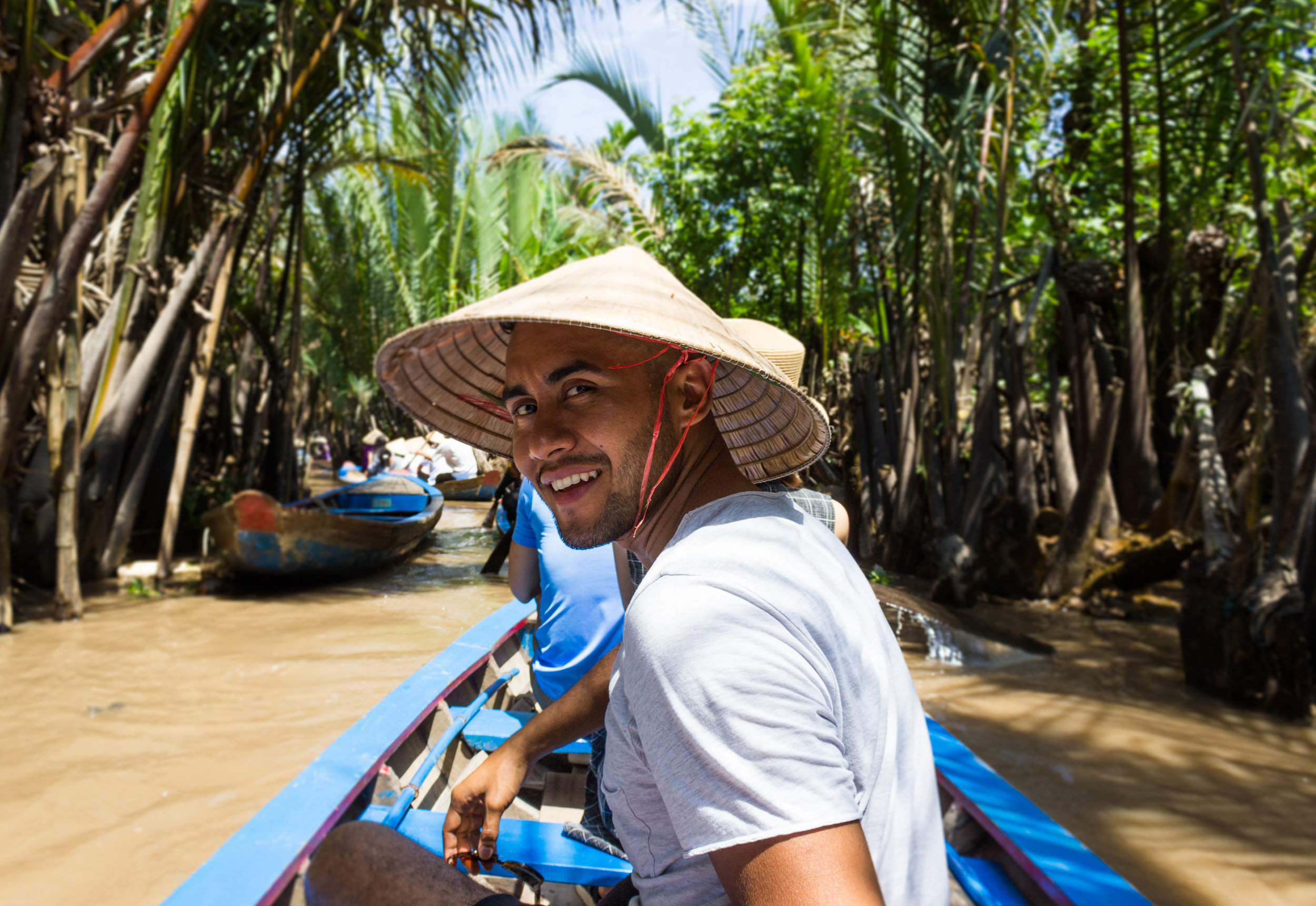 Riding on small boats in the Mekong River delta
