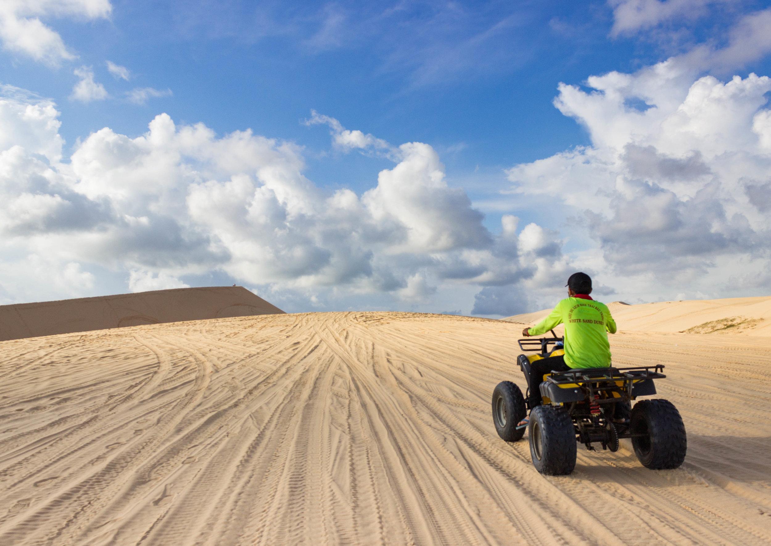 Riding on ATV's in the white sand dunes of Mui Ne