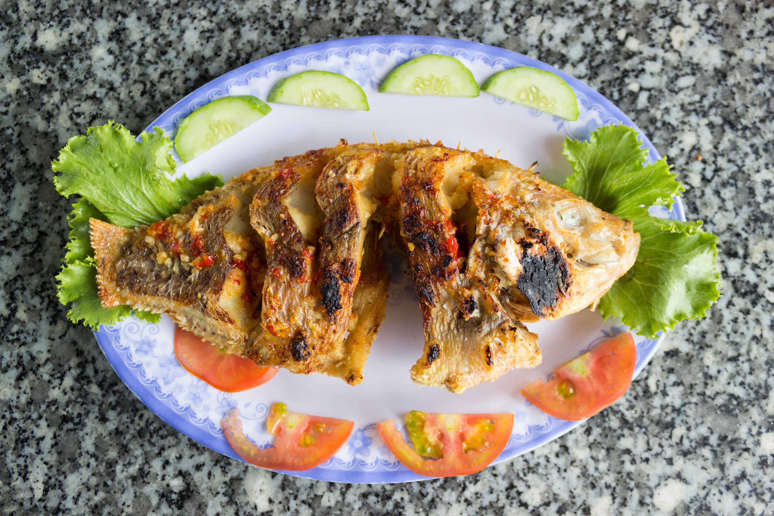 Fresh grilled red snapper seasoned with garlic and chili