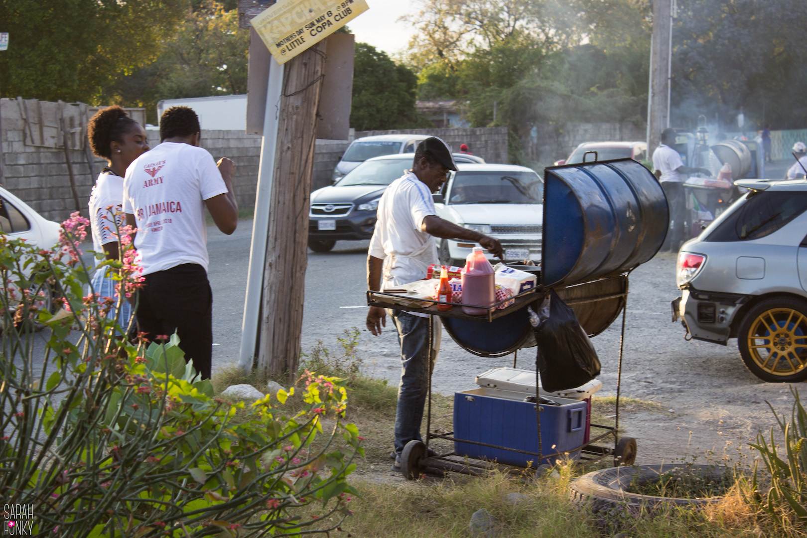 Jamaican's cooking outside of a party