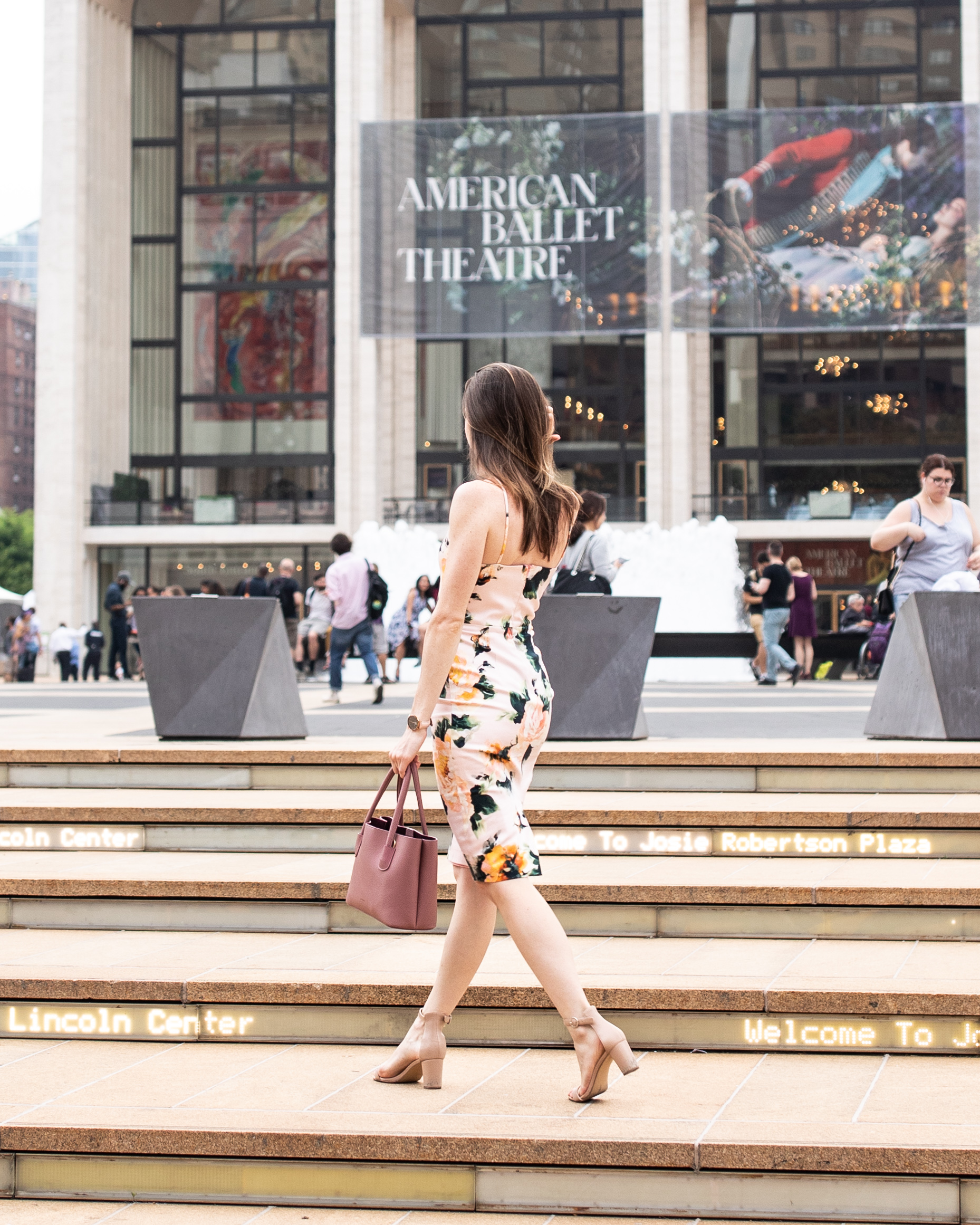 Lincoln Center, Manhattan | Photo by  Jason Gonzalez , Dress by  Black Halo , Purse by  Angela Roi