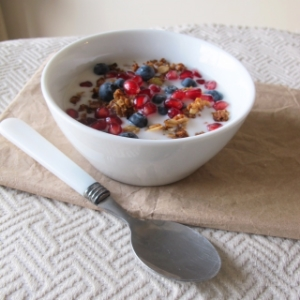 This is my Honey Glazed Granola combined with an unsweetened almond milk, blueberries and pomegranate jewels.
