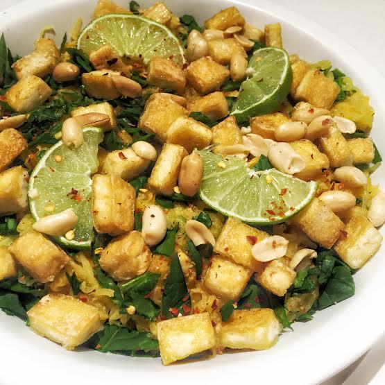 This is my Crispy Tofu & Spaghetti Squash dish-get the recipe   here.