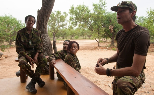 Craig Spencer, right, debriefs the members of the Black Mamba anti poaching unit. Photograph: Jeffrey Barbee