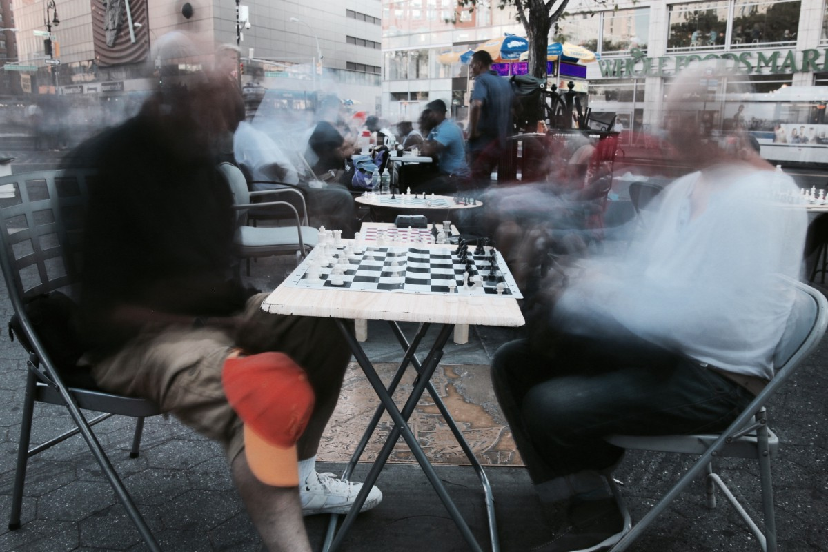 A long exposure image of chess players in Union Square, NYC. Summer 2016. Photograph by the author.