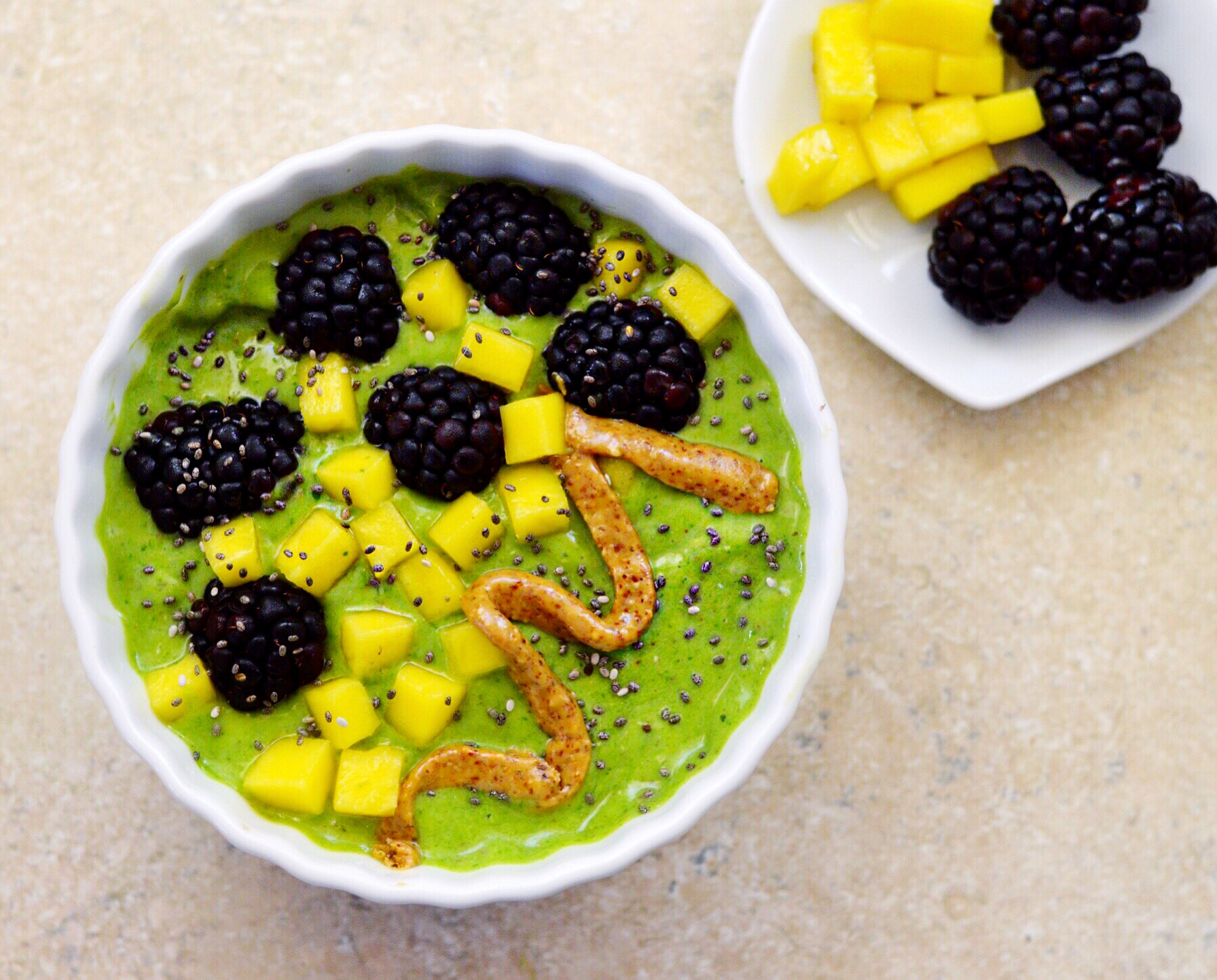 green smoothie bowl with blackberries mango almond butter