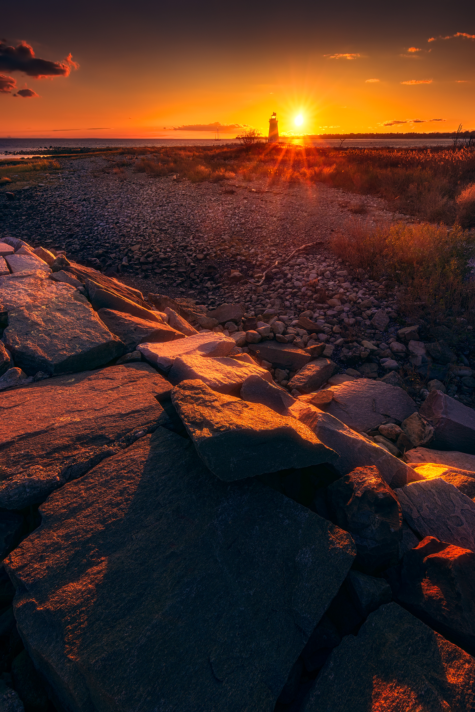 Sunset by Black Rock Light on Fayerweather Island in Bridgeport, Connecticut, USA.