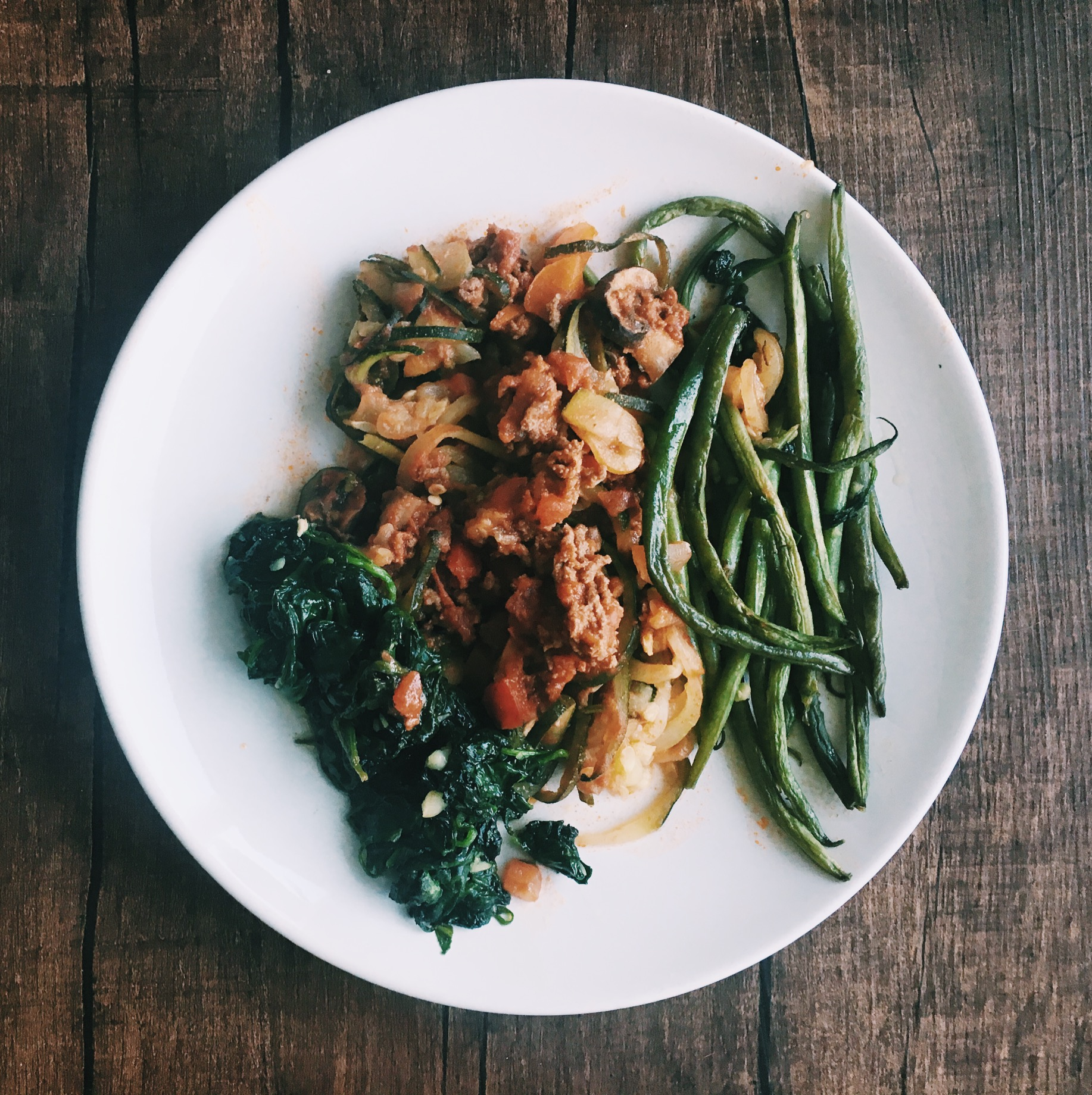 Turkey Spagetti, tomatoes, garlic, peppers, zucchini noodles, whole30 approved spagetti sauce, salt & pepper.   Garlic green beans and garlic spinach both with salt and pepper.