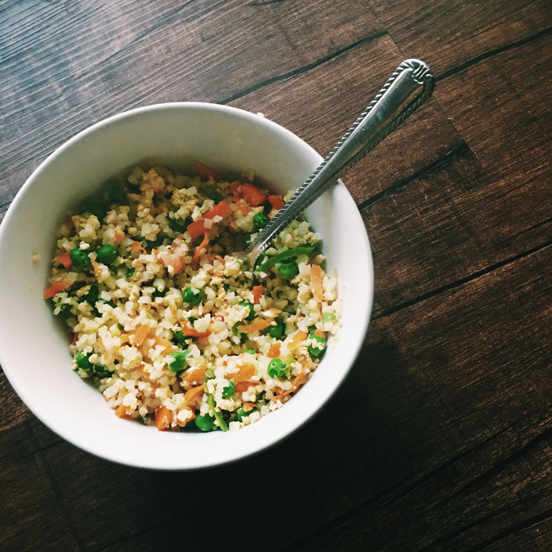 "Cauliflower rice, egg, peas, carrots, coconut aminos, jalapeños s&p ""fried rice"""