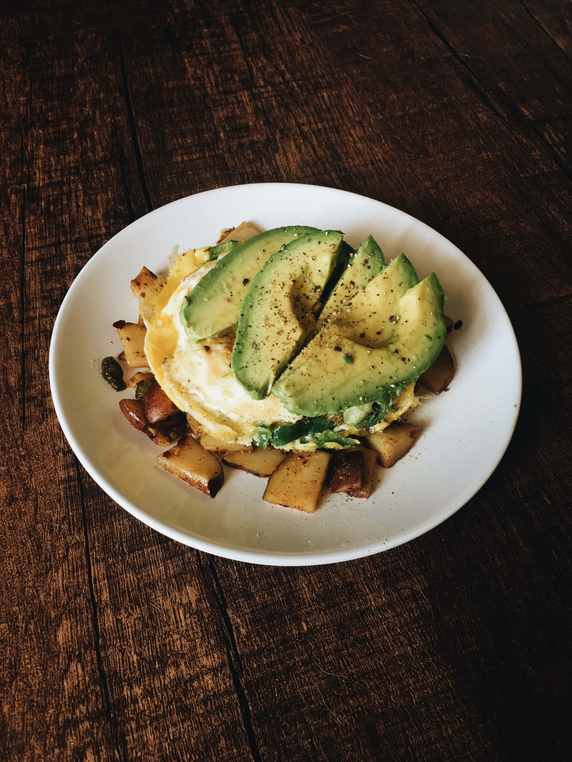 Potato, onion, fried egg, jalepenos, avacado, s&p