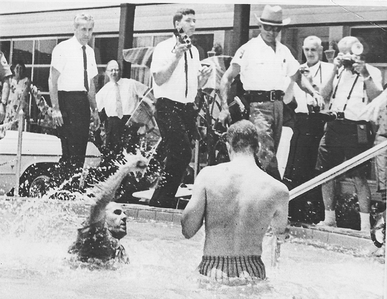 After Brock poured acid in the pool, an off duty police officer jumped into the pool and violently removed the demonstrators, who were all arrested.