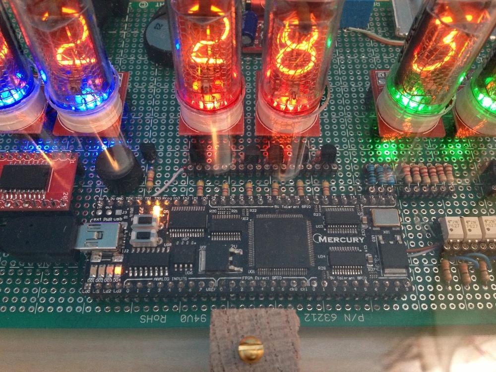 Close-up view showing the RTC, buzzer, Mercury FPGA module, LED driver transistors, and LED & tube series resistors.