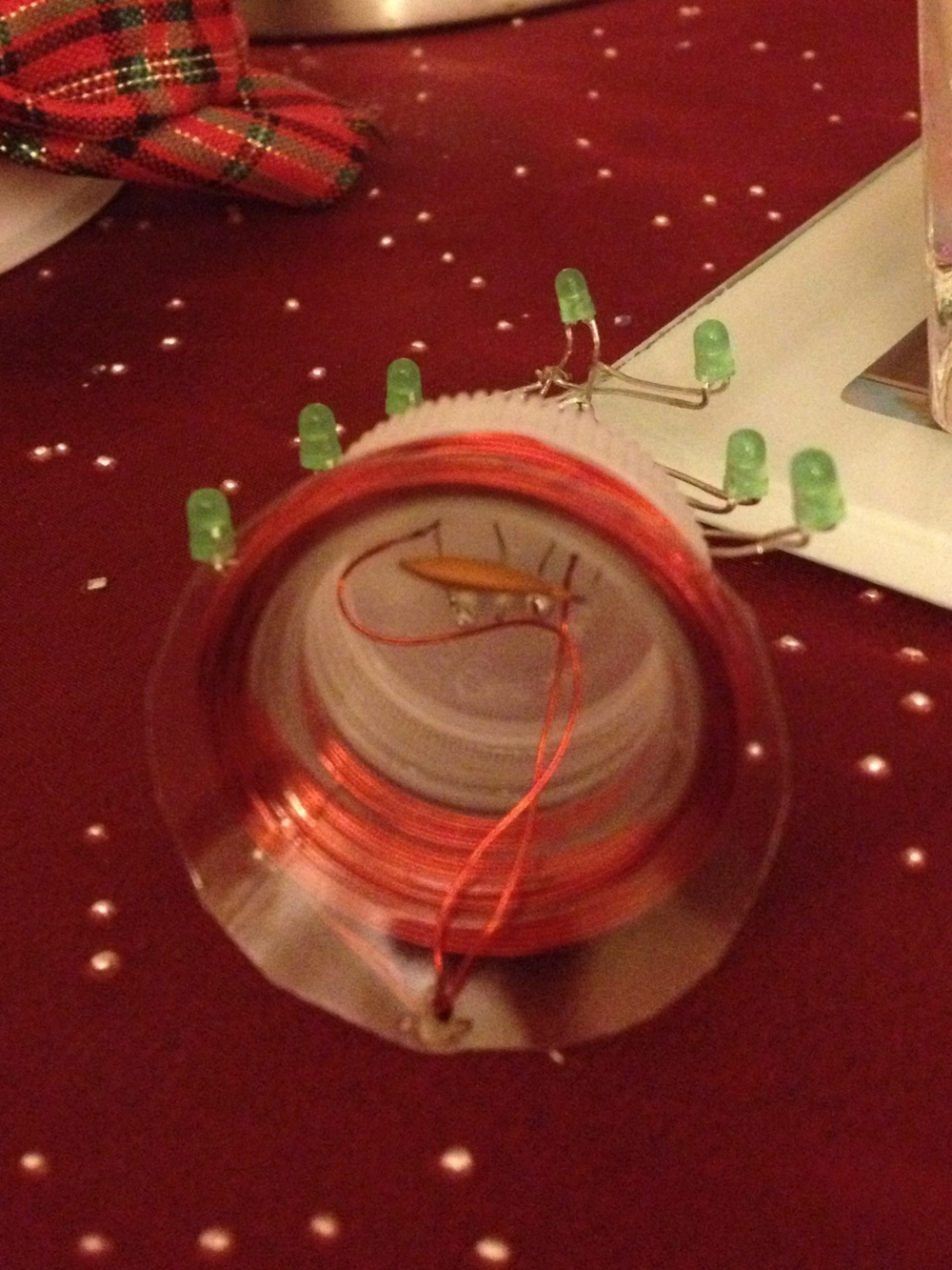Secondary capacitor hiding beneath the Christmas tree.