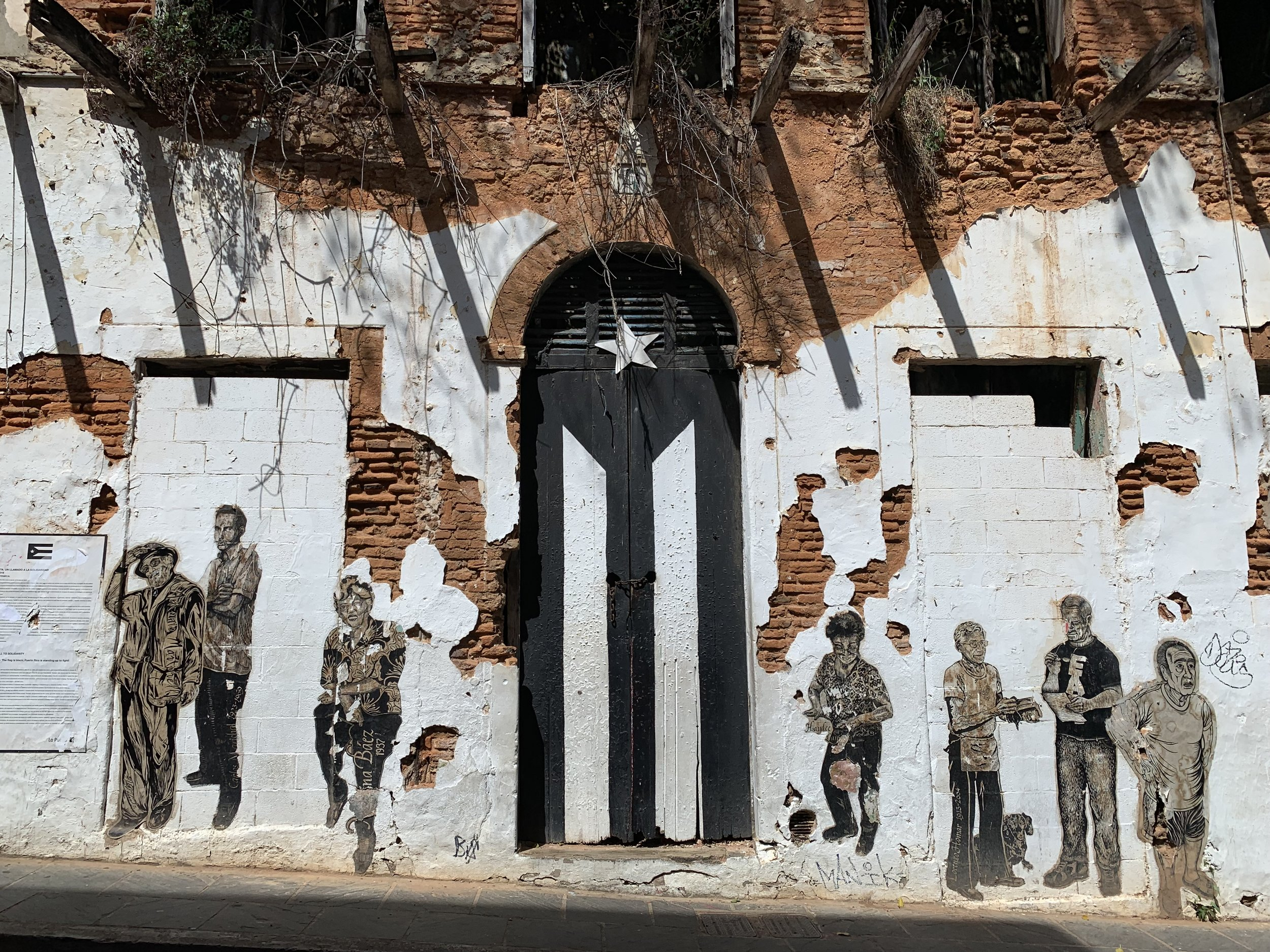 La Puerta de la Bandera, which is  now painted in black and white  in solidarity of the fight for social, economic and political progress in Puerto Rico.