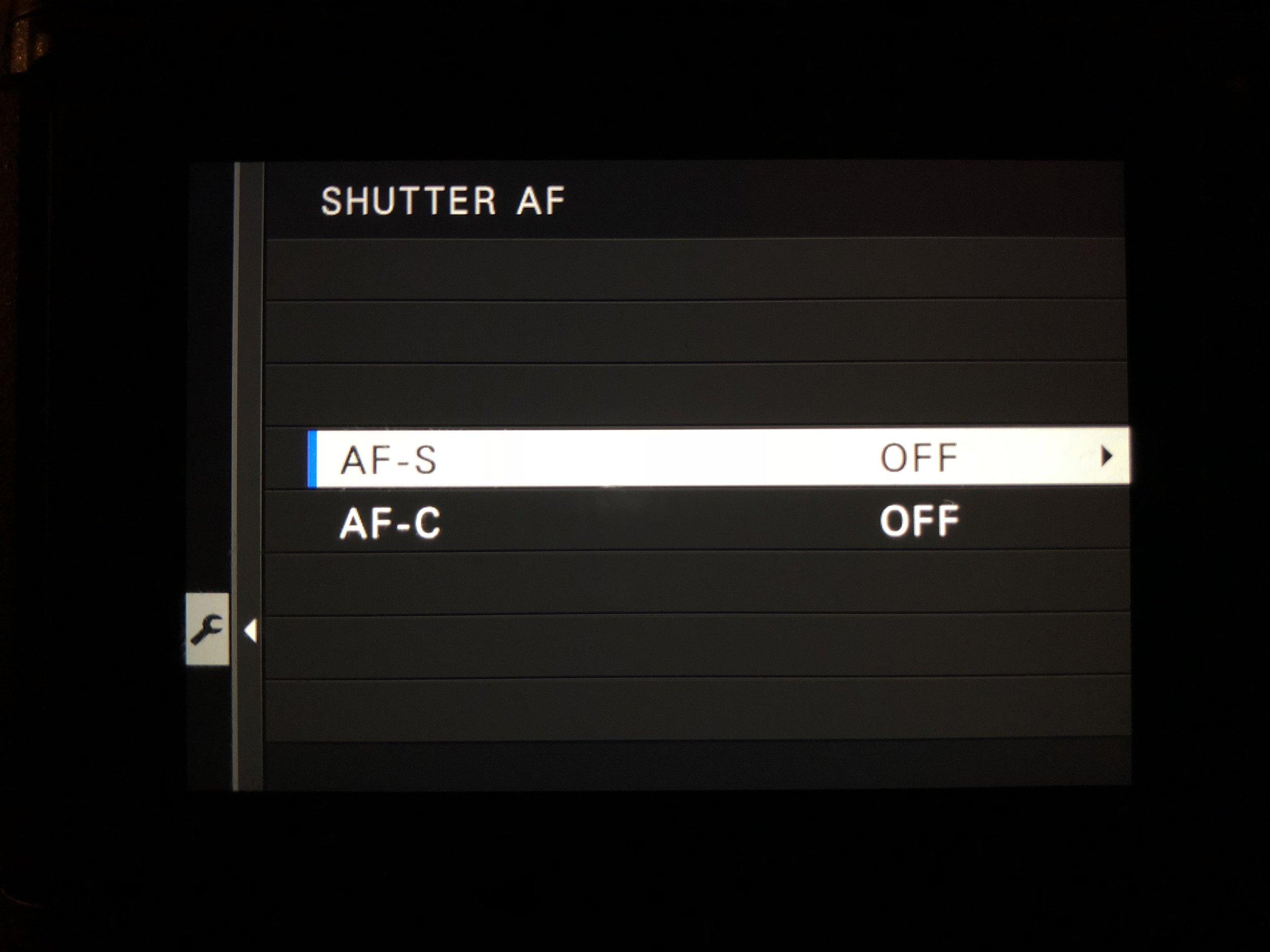 Shutter AF Off - Set Up>Button/Dial Setting>Shutter AF>AF-S>Off