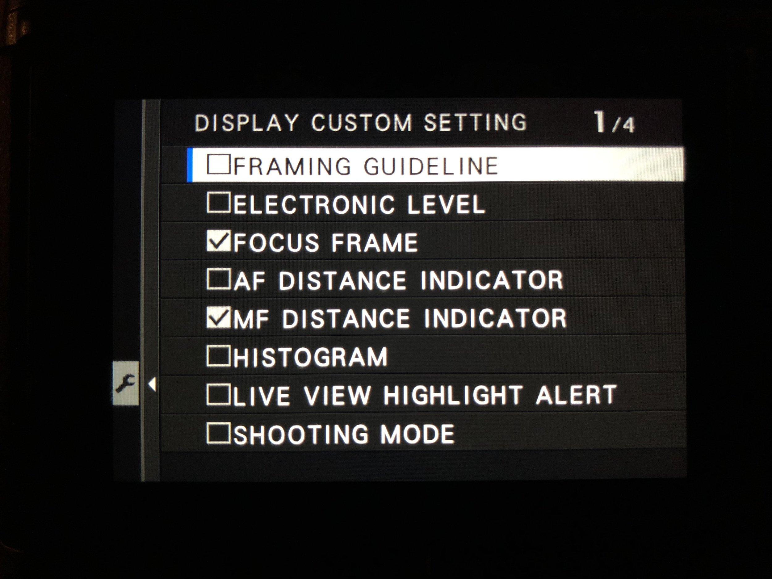 Select MF Distance Indicator - Set Up>Screen Set-Up>Disp. Custom Setting and check MF Distance indicator