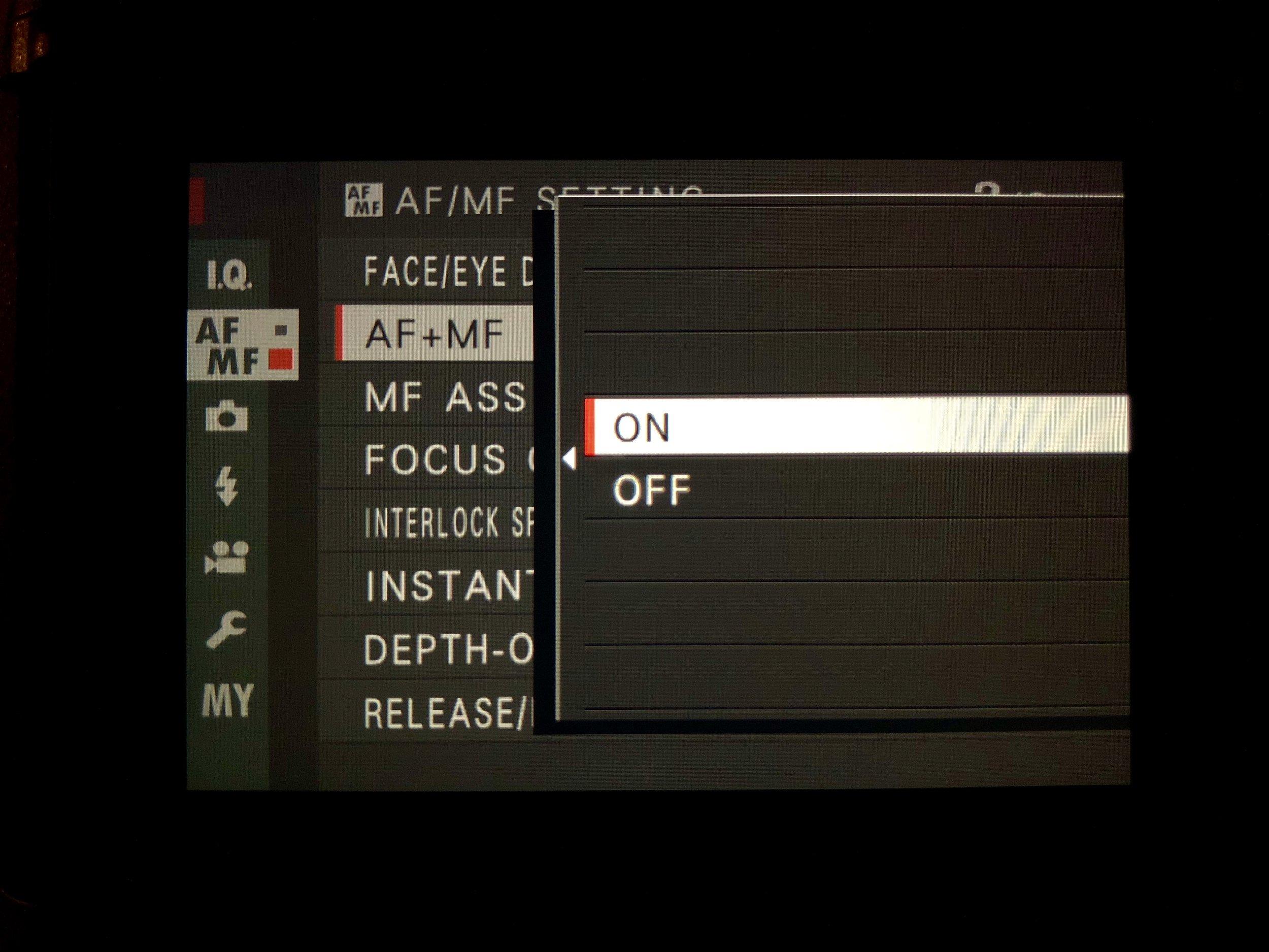 Set AF+MF On - AF/MF Setting>AF+MF>On