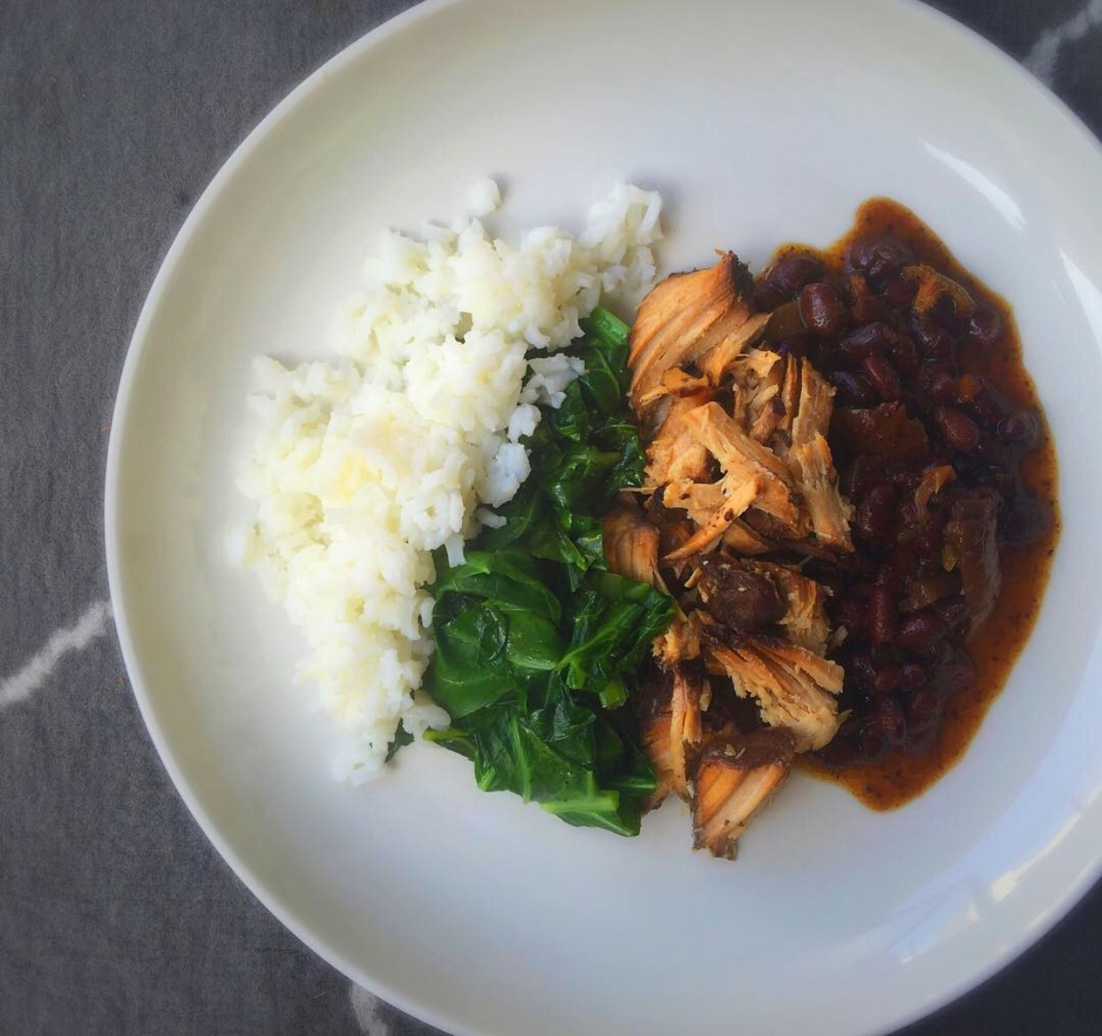 Feijoada - Brazilian pork stew with Rice, Beans, Collards.