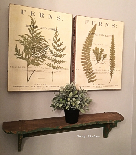 Here is the wall on the other side above the toilet area. We do have these beautiful botanical canvases and 1 green chippy shelf at the shop for sale,