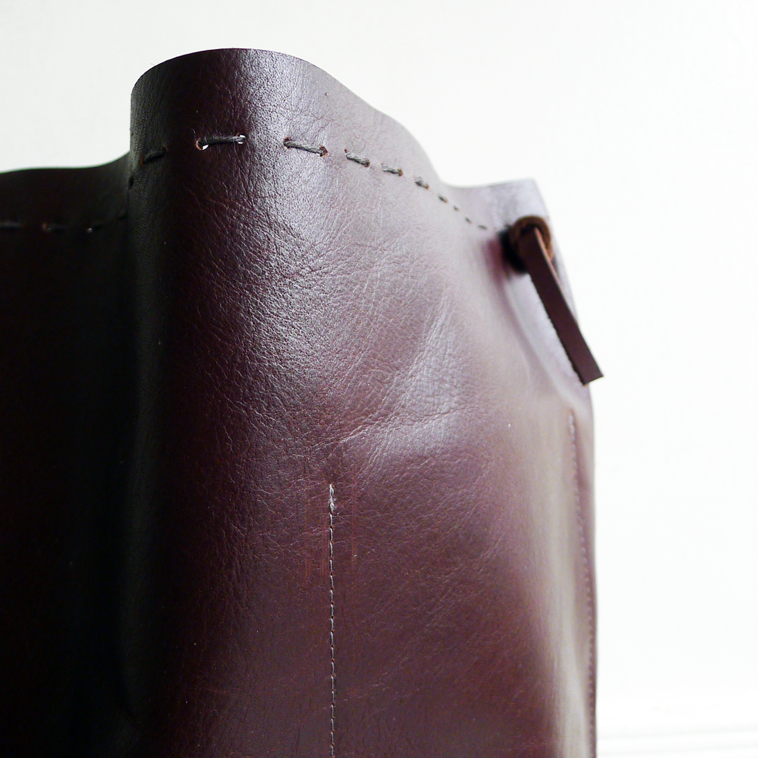 leather back hand stitched edge