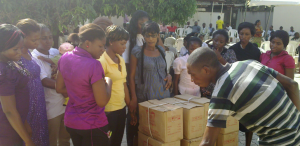 OVC Receiving Sewing Machines at December 2012 Graduation Ceremony