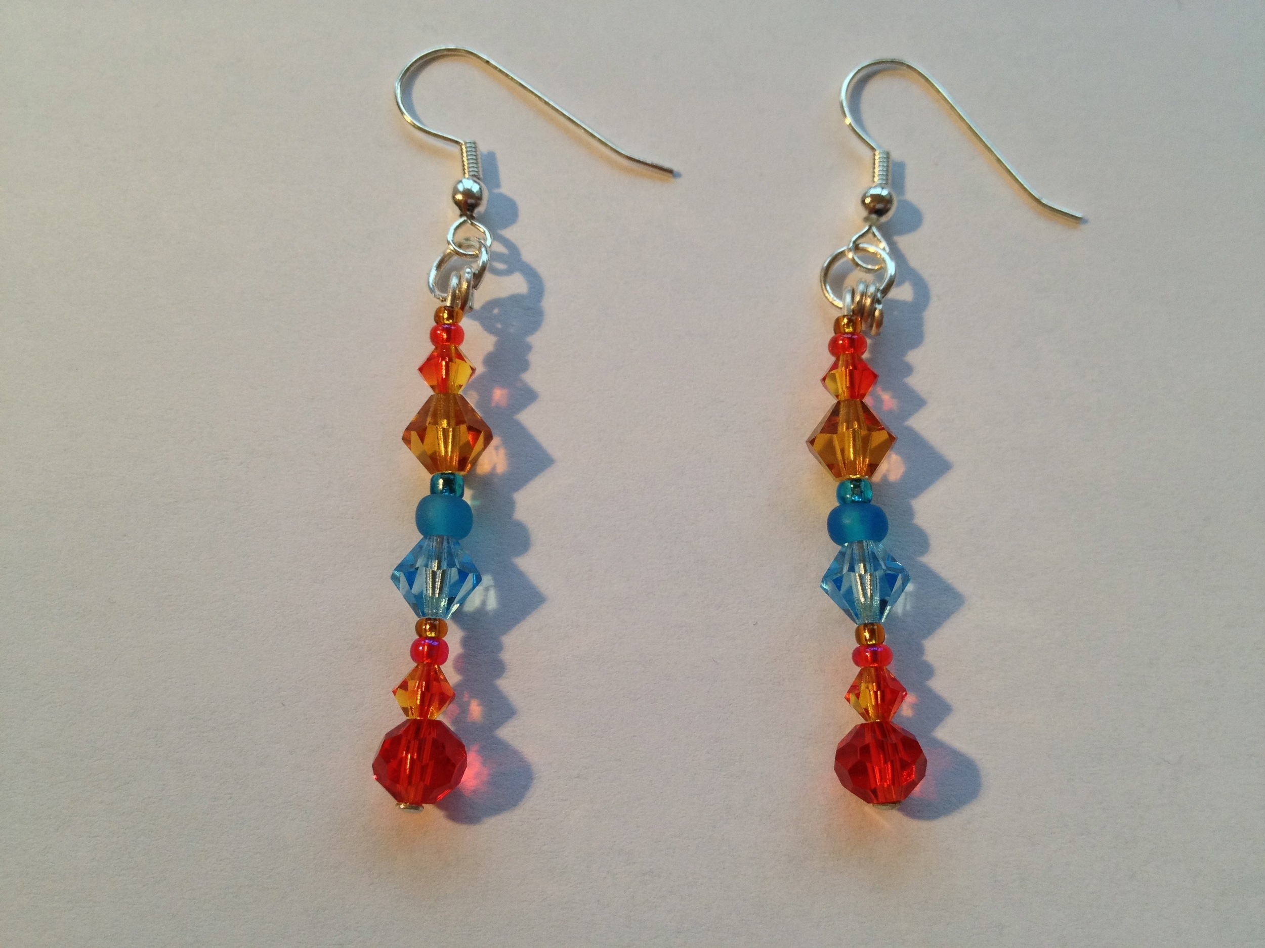 orange blue crystal earrings dangle.jpg