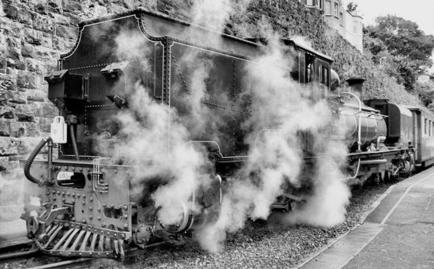 Ex-South African Railways Class 16 Garratt locomotive simmering at Caernarfon on the Welsh Highland Railway  Photo by Tony Richards.