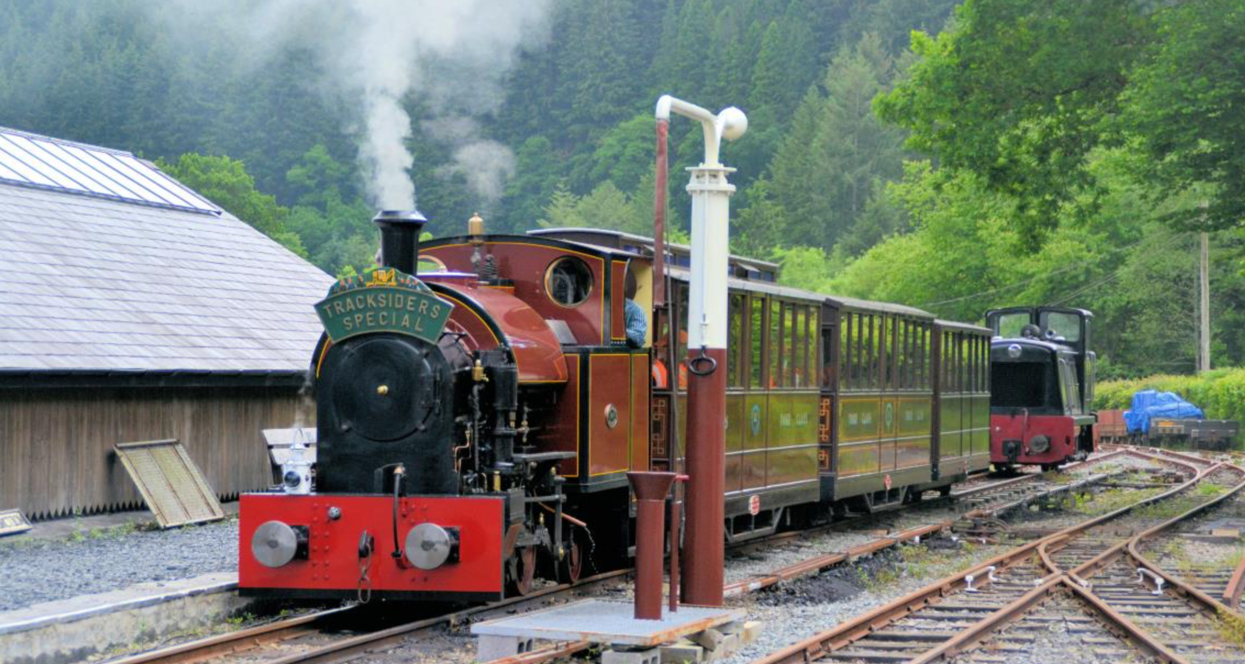 No 7 with three bogie coaches leaving Maespoeth Junction on its return to Corris