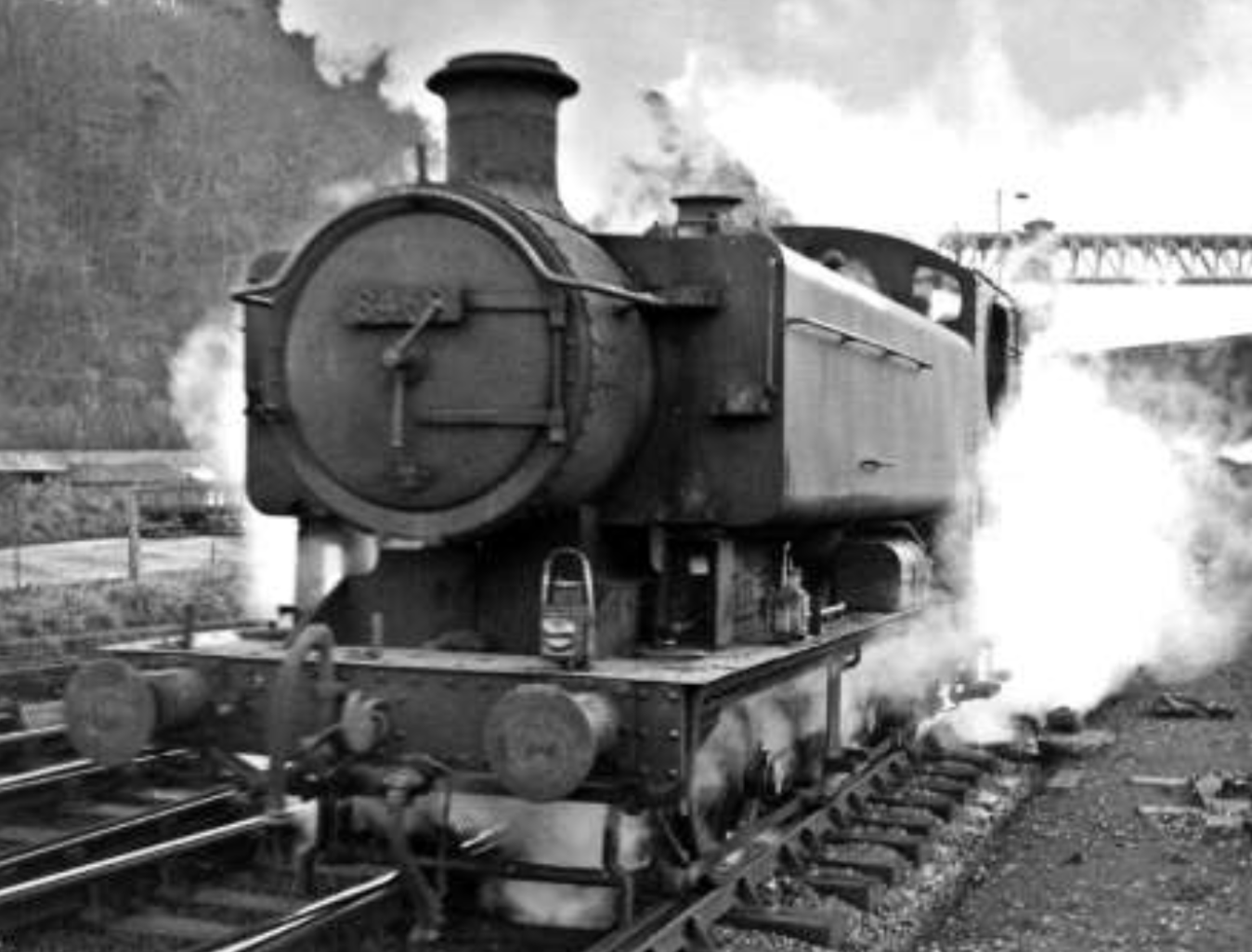 Hawksworth 94XX Pannier 8469 at Walnut Tree Junction, Taff's Well, in early 1964.  A Radyr loco, she was withdrawn months after this shot was taken and had a working life of just 13 years. In the background, spanning the Taff Gorge, is the Barry Railway's magnificent Walnut Tree Viaduct. Photo shown with kind permission of Robert Masterman.