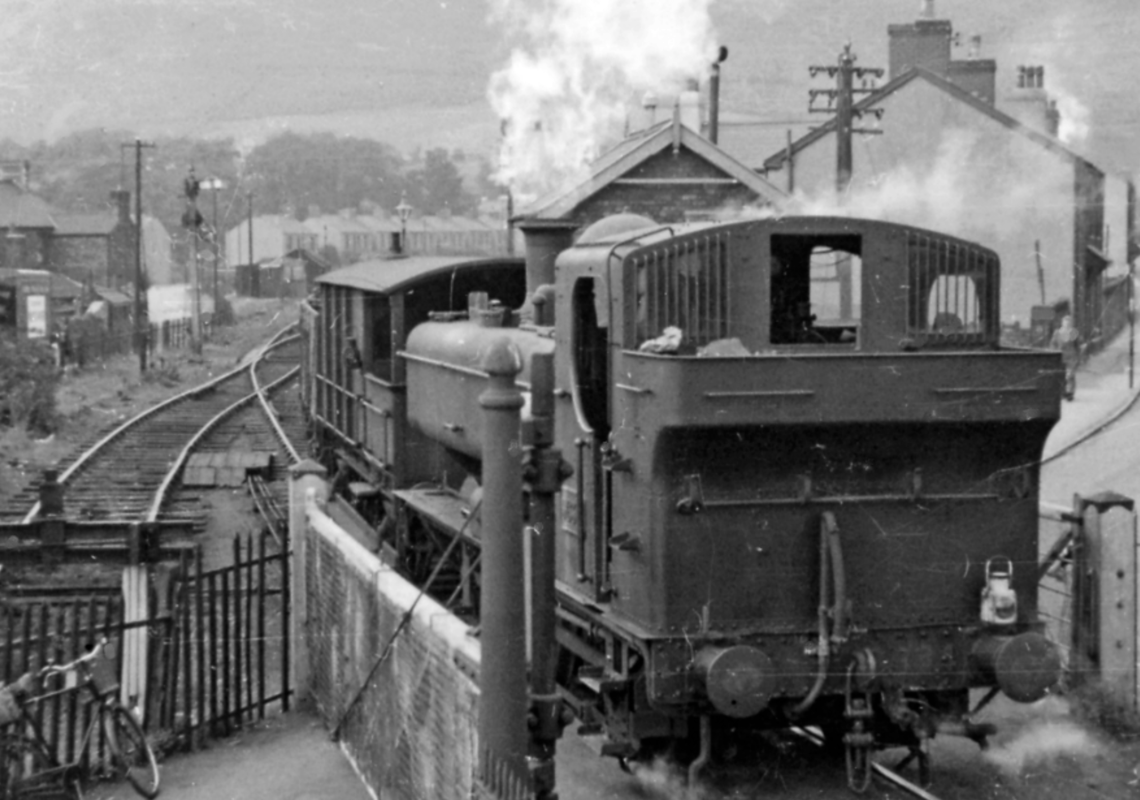 Ex-GW '8750' 0-6-0 pannier tank banking an empties train at Duffryn Junction towards Maesteg.  View north-east up the Duffryn valley on the ex-Port Talbot Railway line - at 1-in-40 - to Maesteg and Pontyrhyll, which was closed to passengers on 11/9/33 and to goods on 31/8/64. The banker is Collett '8750' class 0-6-0 No. 9634 (built 1/46, withdrawn 5/64).  Photo: Ben Brooksbank (Wikimedia Commons)