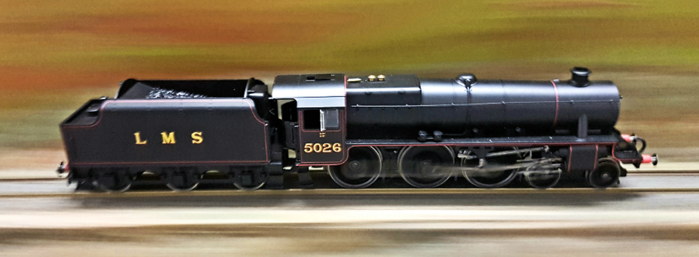 A Hornby Black Five photographed at speed out of doors                                               Photo courtesy of Marty van Doren, Ridgepointe Rail, Queensland, Australia.